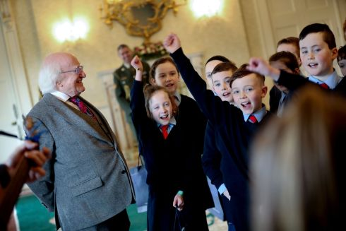 President Michael D Higgins enjoys a song performed by students visiting Áras an Uachtaráin from Ballindery National School, Corofin, Tuam, Co Galway. Photograph: Maxwell's