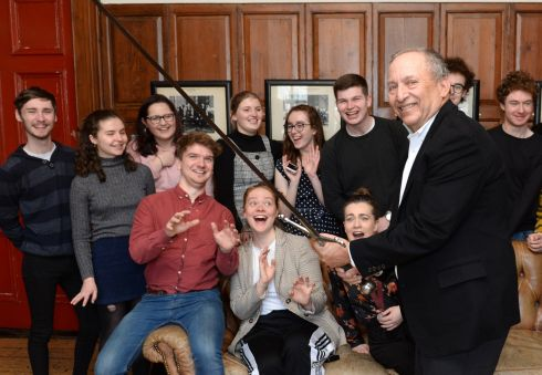 US economist and former US treasury secretary Lawrence Summers holds a sword with members of the Philosophical Society, during a visit to Trinity College Dublin. Photograph: Dara Mac Donaill/The Irish Times