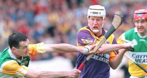 Wexford's Tom Dempsey in action against Billy Dooley and Martin Hanamy of Offaly at Croke Park in June 1999. Photograph: Joe St Leger/The Irish Times