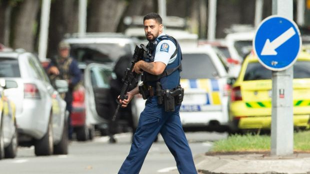 Armed police patrol following a shooting resulting in multiply fatalies and injuries at the Masjid Al Noor on Deans Avenue in Christchurch, New Zealand. Photograph:Martin Hunter/ EPA