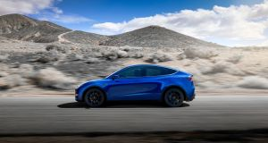 The Model Y will be able to sit seven, using a third collapsible row of seats, and has a glass roof, like the X.