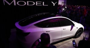 The Model Y resembles a shrunken version of Tesla's Model X. Unlike that car, though, it does not have rear doors that open vertically