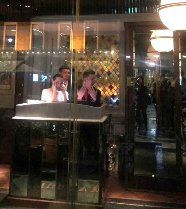 Staff inside The Ivy restaurant on Thursday night as a protest took place outside. Photograph: Áine McMahon
