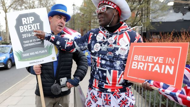 Anti-Brexit campaigner Steve Bray talks with pro-Brexit supporter Joseph Afrane near the Houses of Parliament in London on Wednesday. Photograph: Isabel Infantes/AFP/Getty Images)