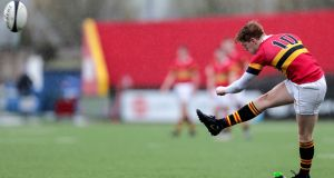 Christian Brothers'  Cian Whooley kicks a conversion against Ard Scoil Ris in the Munster Schools Senior Cup semi-final earlier this month. Photograph:   Laszlo Geczo/Inpho