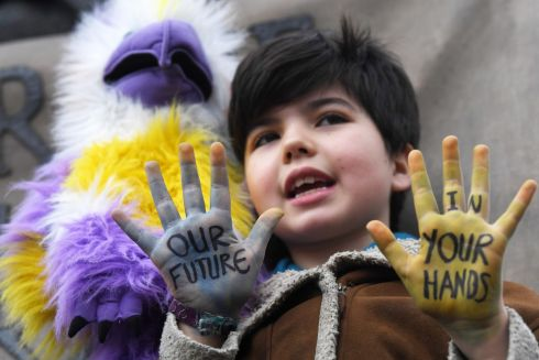 A young boy takes part in a demonstration against climate change during a Friday Global Climate Strike in Parliament Square in London, Britain, 15 March 2019. Students across the world are taking part in a massive global student strike movement called #FridayForFuture which was sparked by Greta Thunberg of Sweden, a sixteen-year-old climate activist who has been protesting outside the Swedish parliament every Friday since August 2018.  EPA/NEIL HALL