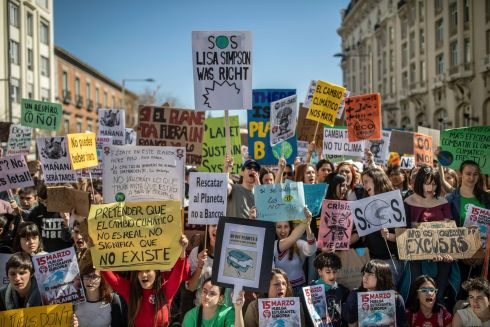 Students hold pro-environment banners during a rally in Madrid, Spain, Friday March 15, 2019. Students mobilized by word of mouth and social media skipped class Friday to protest what they believe are their governments' failure to take tough action against global warming. (AP Photo/Bernat Armangue)