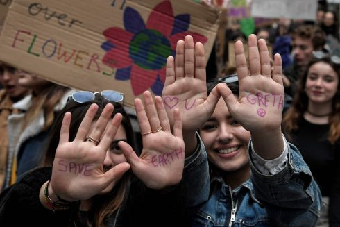 Youth shows writing refering to activist Greta Thunberg as they participate in a demonstration against climate change in Athens on March 15, 2019. - The worldwide protests were inspired by Swedish teen activist Greta Thunberg, who camped out in front of parliament in Stockholm last year to demand action from world leaders on global warming. (Photo by Louisa GOULIAMAKI / AFP)LOUISA GOULIAMAKI/AFP/Getty Images