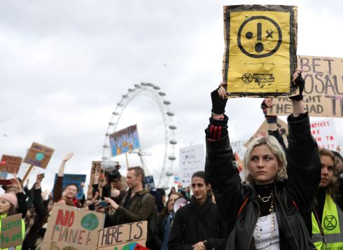 "Young demonstrators hold placards as they attend ""Global Strike 4 Climate"" protest march in central London on March 15, 2019. - Hundreds of young people took to the streets to demonstrate Friday, with some of them having gone on strike from school, as part of a global youth action over climate change. (Photo by ISABEL INFANTES / AFP)ISABEL INFANTES/AFP/Getty Images"