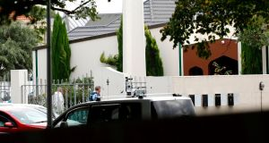 Security officials guards at the mosque Masjif Al-Noor after a gunman filmed himself firing at worshippers inside in Christchurch, New Zealand. Photograph: Tessa Burrows/AFP/Getty Images