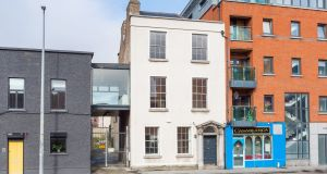 116 Cork Street, Dublin 8, is a three-level property featuring a unique 'floating' glass  studio