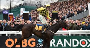 Irish jockey Paul Townend rides Al Boum Photo to win the Gold Cup on the final day of the Cheltenham Festival. Photograph: Glyn Kirk/AFP/Getty Images