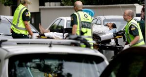 Ambulance staff take a man from outside a mosque in central Christchurch in New Zealand. Photograph: Mark Baker