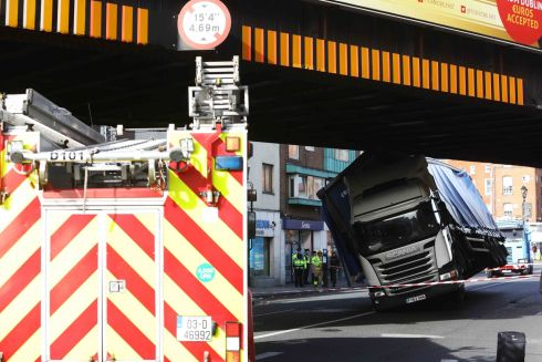 BRIDGE STRIKE: Pictured is a truck struck which struck the railway bridge on Amiens Street, Dublin on Friday afternoon. Train services between Connolly Station and Pearse Station were suspended for just over an hour and there were traffic delays in the area as a result. Photograph: Leah Farrell/rollingnews.ie