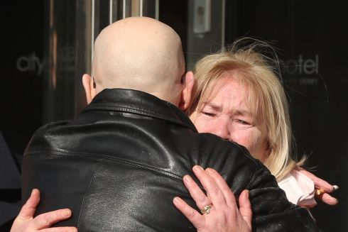 EMBRACE: Linda Nash, whose youngest brother, William Nash, died on Bloody Sunday with Eamonn McCann outside the City Hotel in Derry, ahead of the announcement as to whether 17 former British soldiers and two former members of the Official IRA would be prosecuted in connection with the events of Bloody Sunday in the city in January 1972. Photograph: Niall Carson/PA Wire