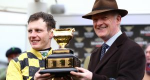 Jockey Paul Townend and trainer Willie Mullins with the Gold Cup following the winning ride on Al Boum Photo in the Magners Cheltenham Gold Cup. Photograph: Michael Steele/Getty