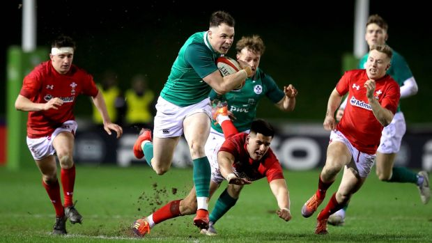 Ireland's Seán French skips past Tiaan Thomas-Wheeler of Wales during the Under-20 Six Nations match in Colwyn Bay. Photograph: Ryan Byrne/Inpho
