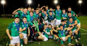 Ireland players celebrate after beating Wales in Colwyn Bay to secure the Grand Slam. Photograph: Ryan Byrne/Inpho