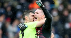 Sheffield United goalkeeper Dean Henderson  and defender  John Egan celebrate the win after the Championship match against Leeds at Elland Road. Photograph:  Richard Sellers/PA Wire