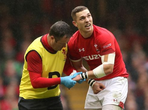 Wales' George North receives medical attention after sustaining an injury. Photo:  Reuters/Peter Cziborra