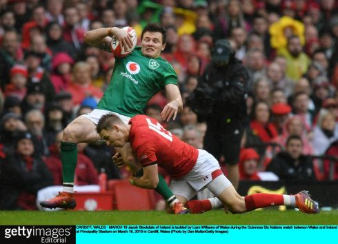 Jacob Stockdale is tackled by Liam Williams. Photo: Dan Mullan/Getty Images