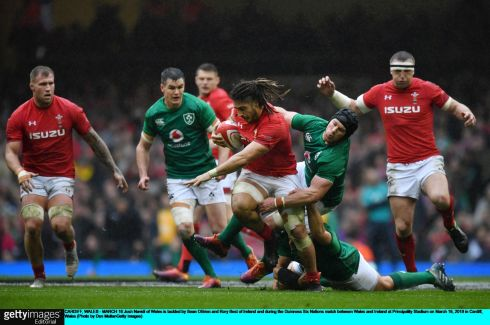 Josh Navidi of Wales is tackled by Sean O'Brien and Rory Best. Photo: Dan Mullan/Getty Images