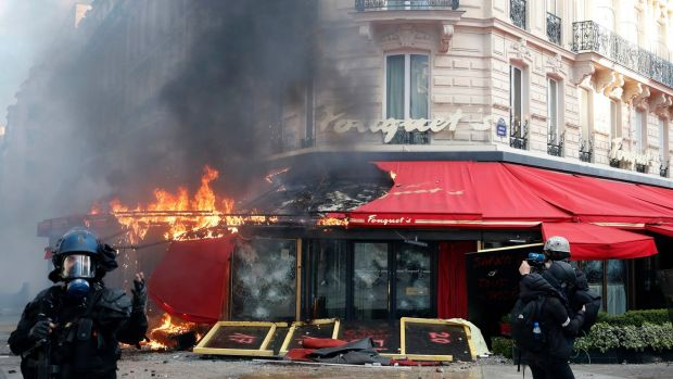 Famed Paris restaurant Fouquet's burns on the Champs Elysees during a yellow vests demonstration on Saturday. Photograph: Christophe Ena/AP Photo