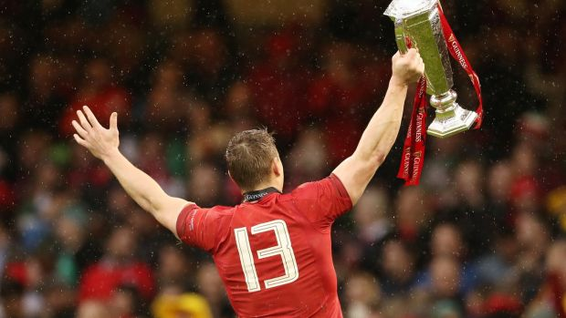 Jonathan Davies celebrates completing the Grand Slam.