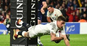 England's George Ford dives over the line to score England's final try.  The game finished 38-38. Photo:   Glyn Kirk/Getty Images