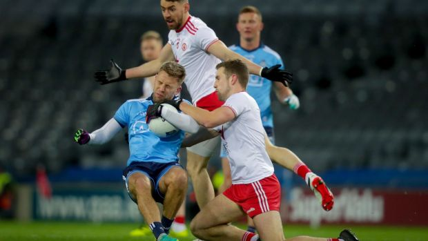 Dublin's Jonny Cooper is tackled by Niall Sludden of Tyrone during the Allianz Football League Division 1 match at Croke Park. Photograph: Oisín Keniry/Inpho