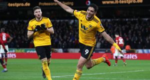 Wolverhampton Wanderers' Raul Jimenez celebrates scoring his side's first goal alongside team-mate Matt Doherty during the  FA Cup quarter-final against Manchester United at  Molineux. Photograph:   Chris Radburn/PA Wire