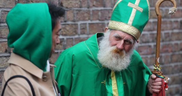 A Japanese tourist chats with a busker dressed as St Patrick in Temple Bar as Dublin's St Patrick's Day Festival begins. Photograph: Niall Carson/PA