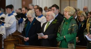 President Higgins and his wife Sabina attend a service in the Pro Cathedral for victims of the New Zealand shootings. Photograph: Dara MacDonaill