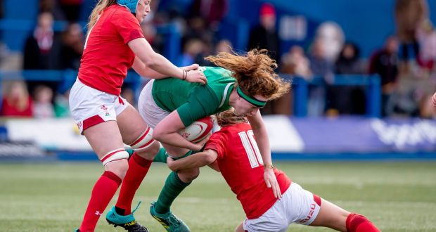 2bb0ffbbf Wales  Gwen Crabb tand Jess Kavanagh tackle Aoife McDermott of Ireland  during the women s Six
