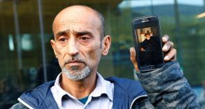 Omar Nabi speaks to the media about losing his father Haji Daoud in the mosque attacks. Photograph: Edgar Su/Reuters