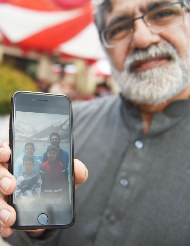 Rizwan Rashid, brother of Pakistani national Naeem Rashid, who was killed in the attacks to the Christchurch mosques in New Zealand, shows his family picture. Photograph: Farooq Naeem/AFP/Getty