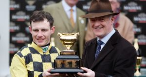 Paul Townend and Willie Mullins celebrate with the Gold Cup after Al Boum Photo's victory at Cheltenham. Photograph: Paul Childs/Reuters
