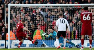Liverpool's James Milner scores their second goal from a penalty during the Premier League win over Fulham at Craven Cottage. Photo: Hannah McKay/Reuters