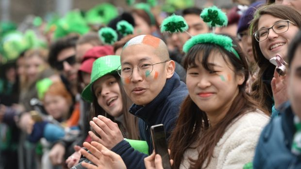 Watching the St Patrick's Day parade in Dublin. Photograph: Dara Mac Dónaill