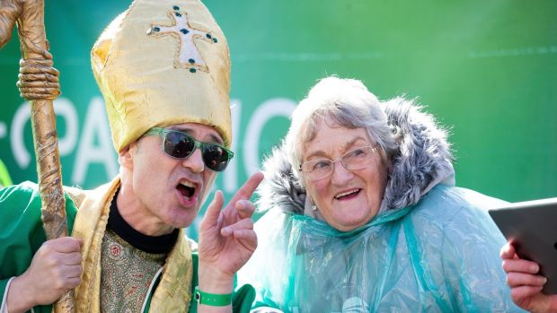 "Irene Mullally from Bangor pictured with ""St Patrick"" at the Dublin parade. Photograph: Tom Honan"