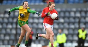 Ashling Hutchings of Cork gets away from Donegal's  Nicole McLaughlin during the Lidl Ladies NFL Division 1  match  at Páirc Uí Rinn. Photograph: Eóin Noonan/Sportsfile