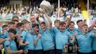 St Michael's Mark Hernan lifts the trophy after they beat Gonzaga to claim the Senior Cup title. Photo: Oisin Keniry/Inpho