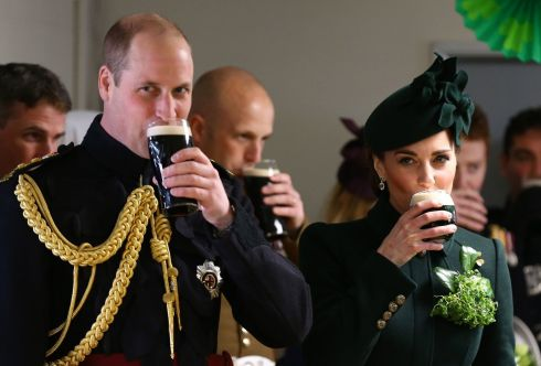 The Duke and Duchess of Cambridge enjoy a pint of Guinness after attending the St Patrick's Day parade at Cavalry Barracks in Hounslow, where she presented shamrock to officers and guardsmen of 1st Battalion the Irish Guards. Photo: Gareth Fuller/PA Wire