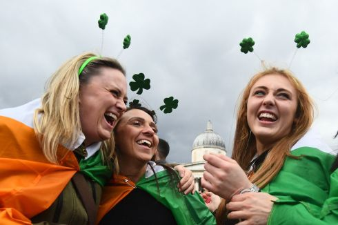 People enjoy St Patrick's Day celebrations at Trafalgar Square, London. Photo: Victoria Jones/PA Wire