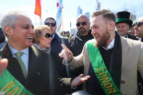 Irish mixed martial artist Conor McGregor (right) joins Mayor of Chicago Rahm Emanuel during the St Patrick's Day Parade in Chicago. Photo: Brian Lawless/PA Wire