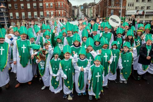 Over 158 Paddys, Pats, Patricias, Patryks and Patricias braved the inclement weather to don St Patrick's costumes and take part in the ultimate St Patrick's Festival  photo to celebrate the restoration of Cork's St Patrick's Bridge. Picture: Clare Keogh