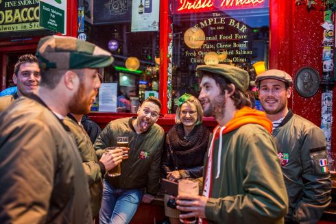 Clement and Lucie from France are seen with their friends in Templebar ahead of St.Patricks Day festival. The group all rode over on mopeds to raise money for charity.Photo: James Forde for the Irish Times