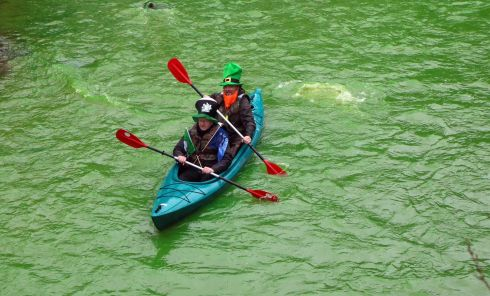 People canoe on the Vilnia river, which has been coloured in green to mark Saint Patrick's Day, in Vilnius, Lithuania. (Photo by Petras Malukas / AFP)PETRAS MALUKAS/AFP/Getty Images