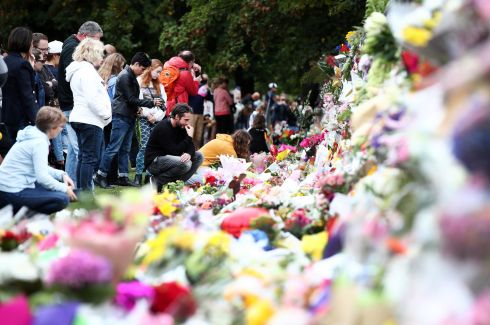 STREET SHRINE: People lay flowers and take time to reflect at a wall of bouquets at the Botanic Gardens in Christchurch, New Zealand, in the wake of the killings of at least 50 people in mosques two days earlier. Photograph: Fiona Goodall/Getty Images