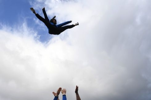 FLYING HIGH: A gymnast takes part  in the St Patrick's Day parade in Galway city. Photograph: Clodagh Kilcoyne/Reuters